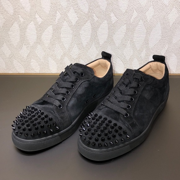 promo code 1ce12 b6212 Christian Louboutin women's spiked black sneakers